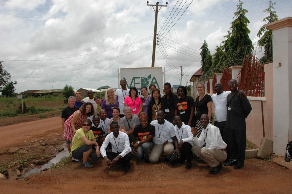 A large group of peopleCare and MEDA team members in Ghana