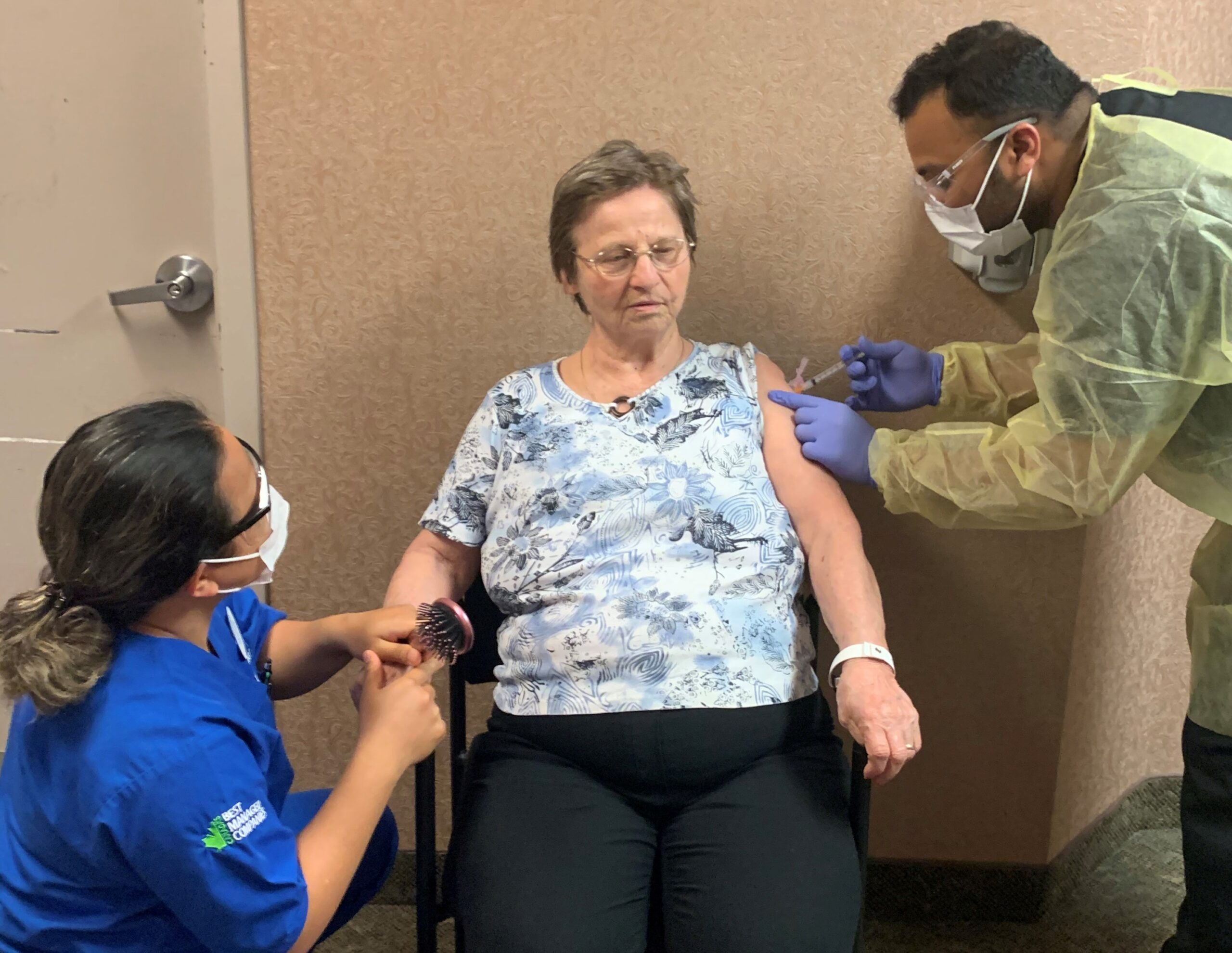 ADOC Angela Dayman and RN Mazar Muhammed give an Oakcrossing LTC resident her COVID vaccine