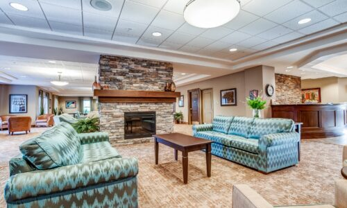 Seating area and fireplace at Oakcrossing Retirement Living