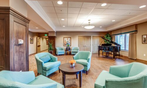 Sitting area and grand piano at Oakcrossing Retirement Living