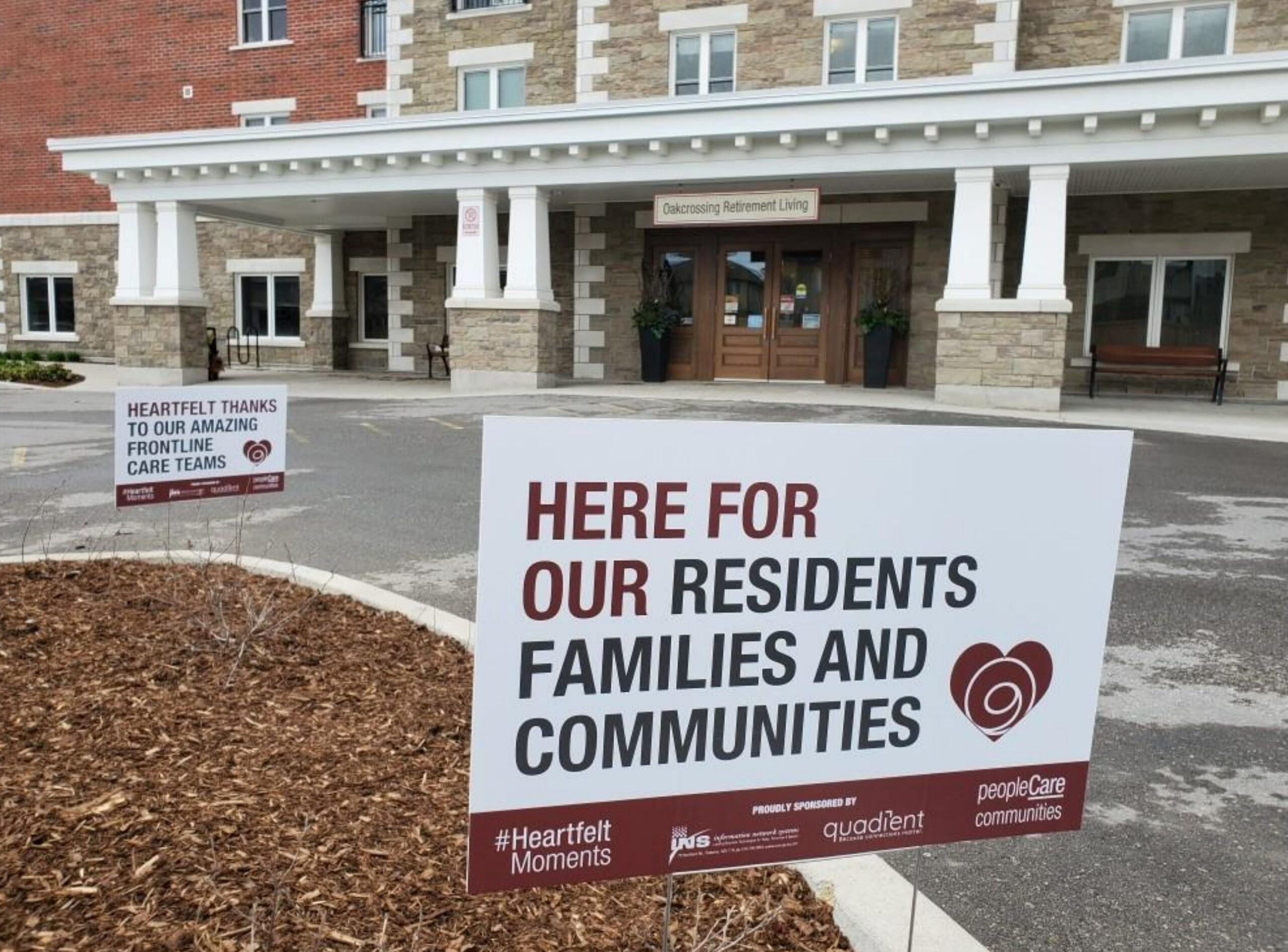 A lawn sign that says here for our residents families and communities in front of retirement home