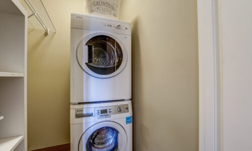 Washing machine and dryer in suite at Oakcrossing Retirement Living