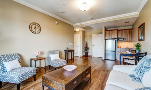 Living room area and kitchenette in suite at Oakcrossing Retirement Living