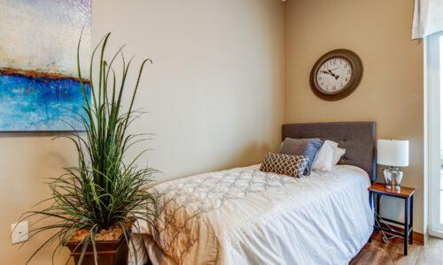 Bed in studio suite at Oakcrossing Retirement Living