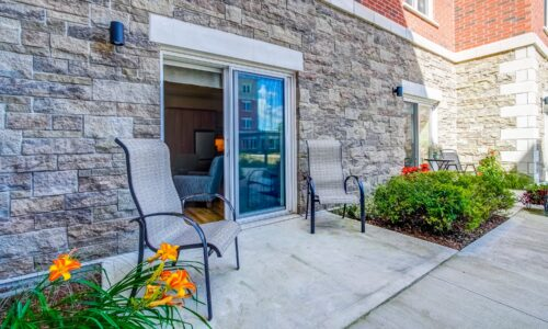 Outdoor patio of studio suite at Oakcrossing Retirement Living