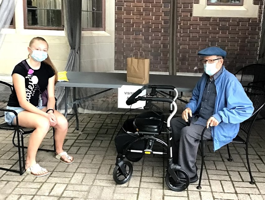 Golden Years LTC resident Adib and student during an outdoor visit at the home