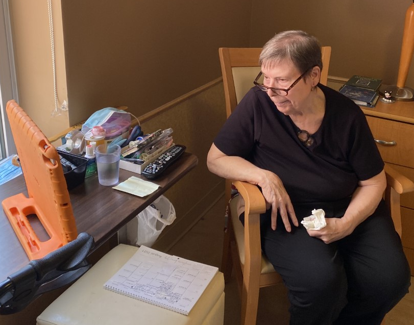 Eleanor, resident at peopleCare Hilltop Manor, chats with her pen pal over Skype